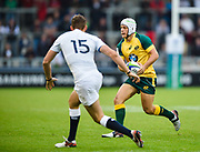 Australia fly-half Mack Mason runs at England full-back Darren Atkins during the World Rugby U20 Championship  match England U20 -V- Australia U20 at The AJ Bell Stadium, Salford, Greater Manchester, England on June  15  2016, (Steve Flynn/Image of Sport)
