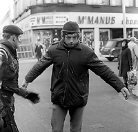 Soldiers on security duty in the run-up to Christmas 1972 routinely search shoppers, workers, etc, visiting the city centre in Belfast, N Ireland, December 1972. Generally it is endured with a mixture of stoicism and indifference, 197212070766b<br />