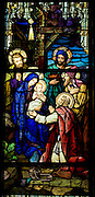 Stained glass image inside Sacred Heart Church, Sherwood, Wis., depicting the Nativity. (Sam Lucero photo)