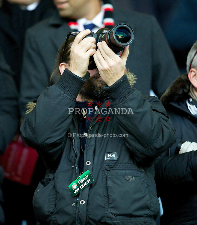 LIVERPOOL, ENGLAND - Saturday, December 10, 2011: A VIP guest in the Liverpool Director's Box films the action during the Premiership match against Queens Park Rangers at Anfield. (Pic by David Rawcliffe/Propaganda)