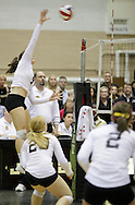 West Point, NY - An Army player leaps to hit the ball at the net against Lehigh in the Patriot League women's volleyball tournament at the United States Military Academy on Nov. 21, 2009.