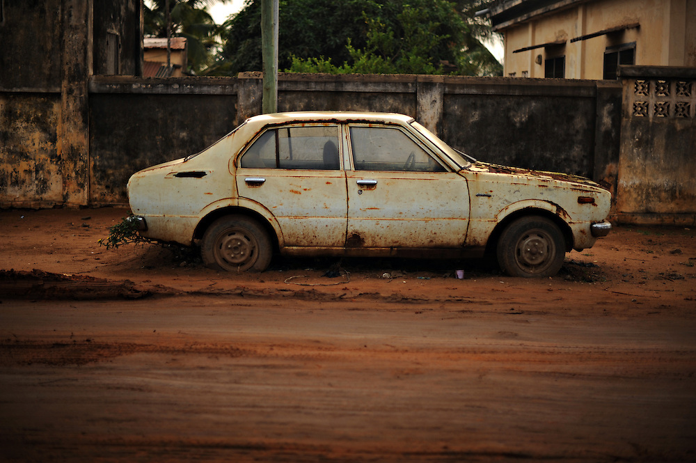 12-01-29  --  ANEHO, TOGO  -- A disused car sits on a roadside in Aneho, Togo. The border town is frequented by fuel smugglers and many local families profit by taking part in the smuggling process. Legally bought in Nigeria, the fuel is loaded onto boats which sail to Togo and Benin under the cover of night.  The fuel is then sold at 15-30 percent less than at licensed stations, providing an inexpensive way for motorists to stay on the road.  Photo by Daniel Hayduk
