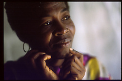 CAP HAITIEN, HAITI - Therese Acenne reminisces about happier days. Her husband was killed trying to flee Haiti when his ramshackle boat sank on the way to the U.S.(PHOTO © JOCK FISTICK)....