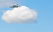 April 27, 2012 - New York, New York USA: Space shuttle Enterprise flies piggyback over New York Harbor. Enterprise was designed as a prototype test vehicle. In July, Enterprise will be on permanent display at the city's Intrepid Sea, Air and Space Museum. (Bill Kotsatos / Polaris)