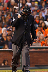 June 6, 2011; San Francisco, CA, USA;  MLB umpire Gerry Davis (12) reacts after getting hit in the arm with a foul ball during the third inning between the San Francisco Giants and the Washington Nationals at AT&T Park.  San Francisco defeated Washington 5-4 in 13 innings.