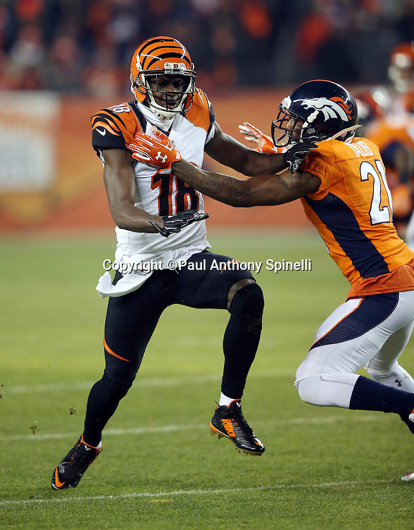 Cincinnati Bengals wide receiver A.J. Green (18) goes out for a pass while covered by Denver Broncos cornerback Aqib Talib (21) during the 2015 NFL week 16 regular season football game against the Denver Broncos on Monday, Dec. 28, 2015 in Denver. The Broncos won the game in overtime 20-17. (©Paul Anthony Spinelli)
