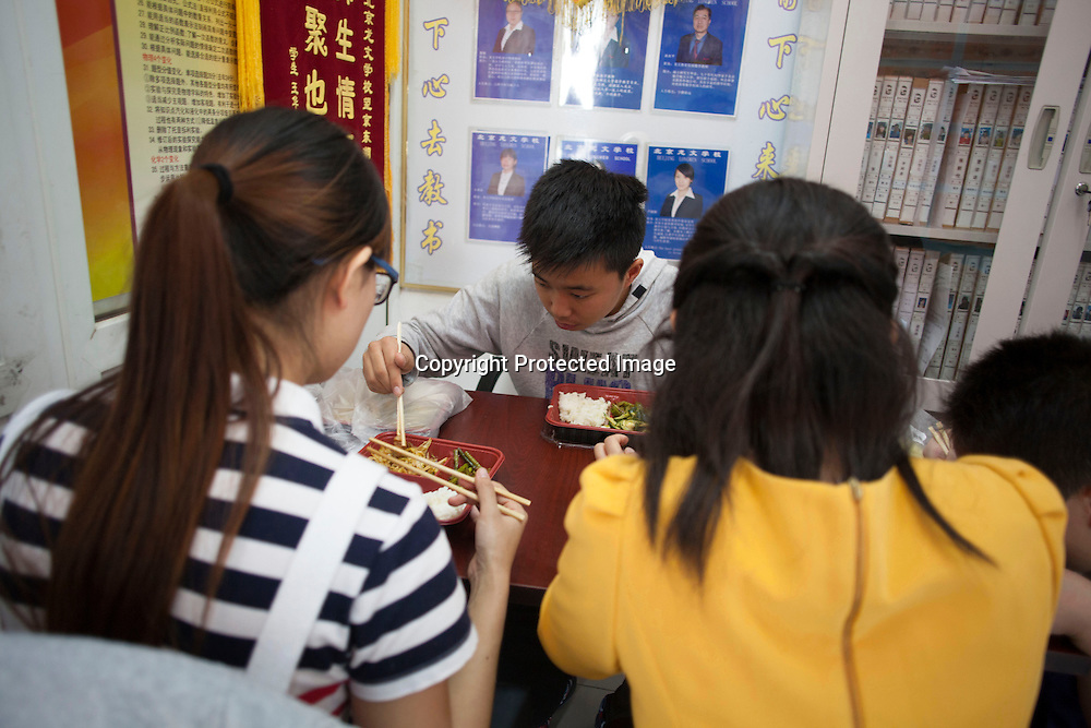 BEIJING, OCT.18, 2014 : Song Yonglin, 14, has lunch with his teachers and classmates . He spends every weekend taking extra school lessons in order to improve his scores which cost his parents about 4-5000 Yuan/month. He would like to switch to the International school in Beijing  and study economics later on in the US.