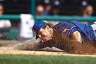 Apr 12, 2011; Detroit, MI, USA;  Texas Rangers left fielder Josh Hamilton (32) slides into home plate and is tagged for the last out during the first inning against the Detroit Tigers at Comerica Park.