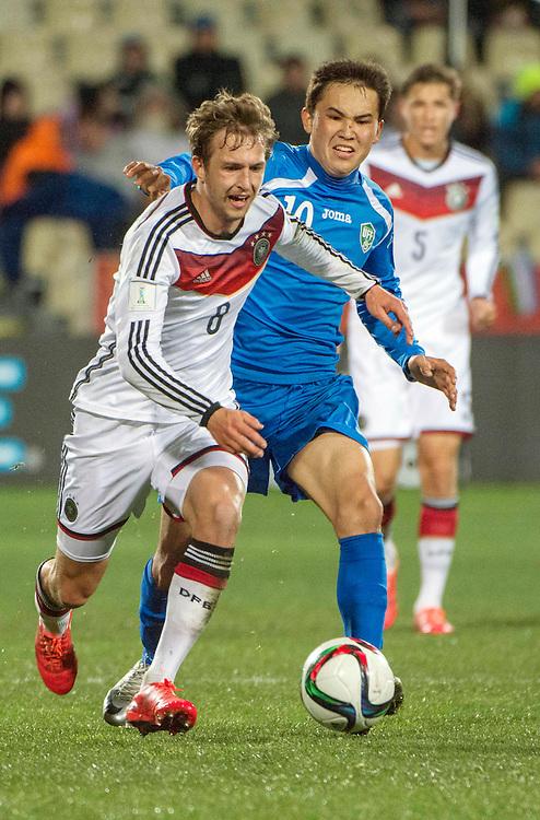 Ville Steinmann, left, of Germany and Otabek Shukurov of Uzbekistan contest for the ball in the Under 20 soccer World Cup match, Christchurch, New Zealand, Thursday, June 04, 2015. Credit:SNPA / David Alexander