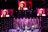 Florence + The Machine performing high angle
