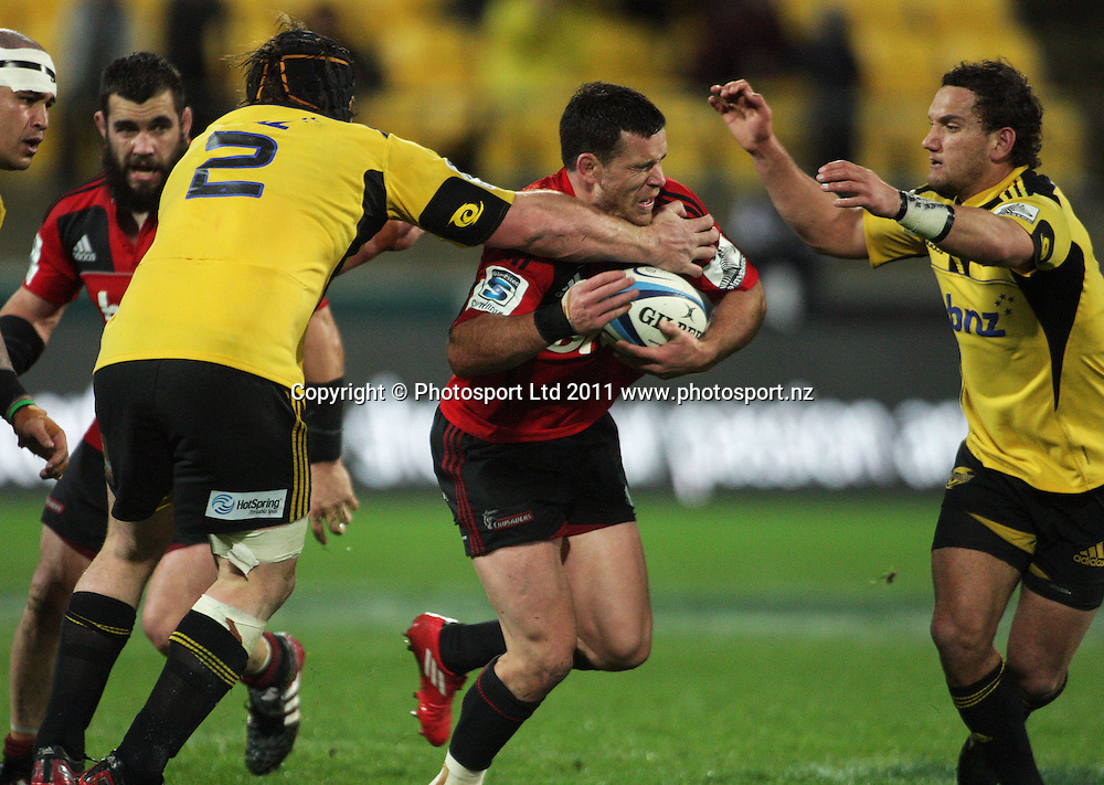 Ryan Crotty tries to break through Andrew Hore and Aaron Cruden. Super 15 rugby match - Crusaders v Hurricanes at Westpac Stadium, Wellington, New Zealand on Saturday, 18 June 2011. Photo: Dave Lintott / photosport.co.nz