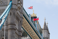 © Licensed to London News Pictures. 12/09/2017. LONDON, UK.  The red ensign celebrating London International Shipping Week flies next to the Union Jack flag on Tower Bridge. THV Galatea is a Trinity House multi-function ship, designed to carry out marine operations as part of their duty as the General Lighthouse Authority for England, Wales, the Channel Islands and Gibraltar. An estimated 15,000 shipping industry leaders are expected to attend events in London and on board the THV Galatea during International Shipping Week this week. Photo credit: Vickie Flores/LNP