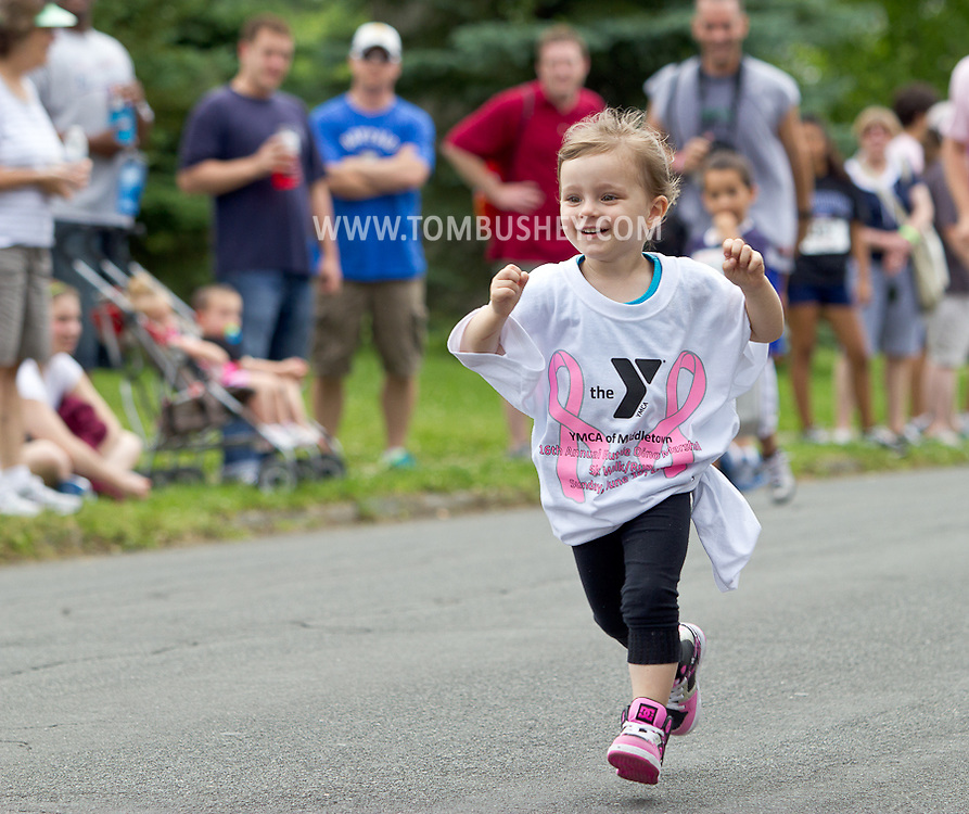 Middletown, New York - A young girl runs down the street during the Kids Dash at the 16th annual Ruthie Dino-Marshall 5K Run/Walk put on by the Middletown YMCA on Sunday, June 10, 2012.