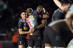Marcus Smith, Ross Chisholm and Semi Kunatani of Harlequins celebrate at the final whistle - Mandatory byline: Patrick Khachfe/JMP - 07966 386802 - 01/12/2019 - RUGBY UNION - The Twickenham Stoop - London, England - Harlequins v Gloucester Rugby - Gallagher Premiership