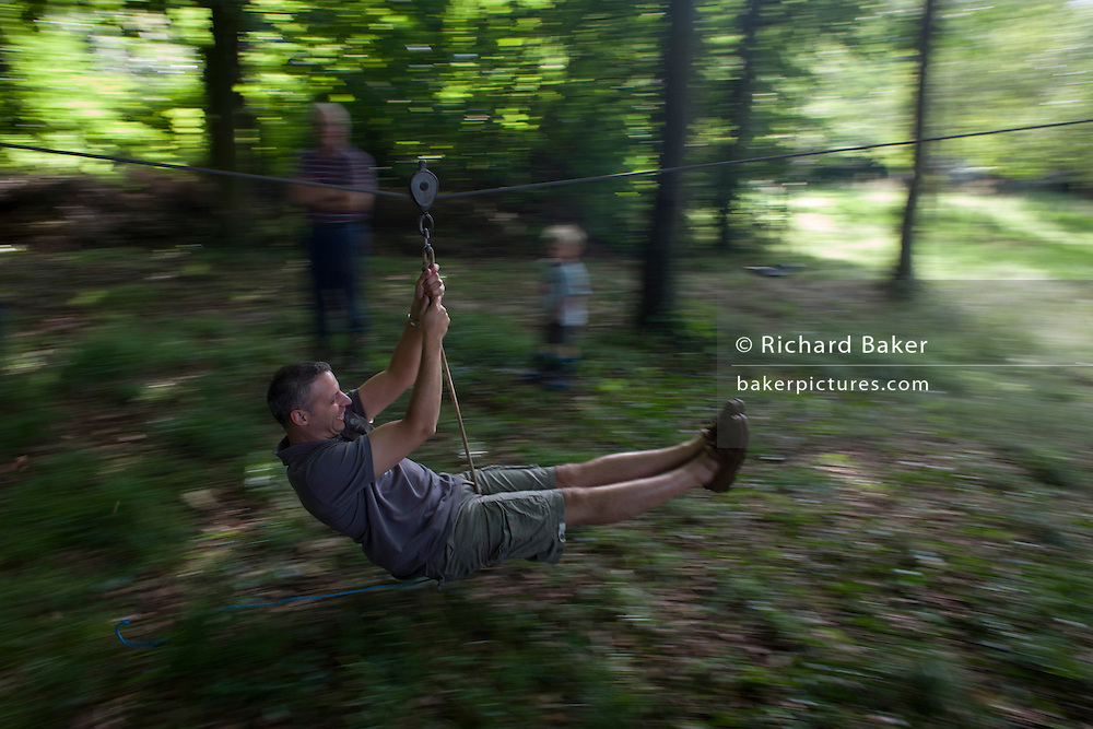 A 40 year-old man blurs across woodland during a home-made zip wire ride on private land in Somerset.