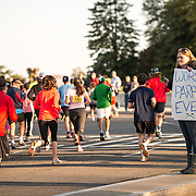 "A spectator cheers on runners in the 2013 Cherry Blossom 10-Mile Run with a sign that reads ""Worst Parade Ever."" Scheduled to coincide with the National Cherry Blossom Festival in early spring, the race takes runners along the National Mall and by the famous cherry blossoms around the Tidal Basin."