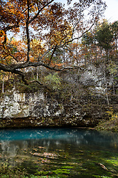Blue Spring is Missouri&rsquo;s sixth largest spring with a discharge of 90 million gallons of water per day. The azure blue depths of Blue Spring reach 310 feet making it Missouri&rsquo;s deepest spring and among the deepest in the United States. Dissolved rock such as limestone and or dolomite, along with the influence of the deep depth of the spring and the blue of the sky, give the spring its blue color. <br /> <br /> Blue Spring is a Missouri Natural Area, a special designation given to areas of outstanding beauty or scientific interest. The area around the spring is managed by the Missouri Department of Conservation, while the Current River and the surrounding area are administered by the National Park Service as part of the Ozark National Scenic Riverways. Blue Spring is located just off the Current River near Owls Bend, an area that historically supported a mill that produced gunpowder and a river ferry which was the only way across the Current River until 1975.<br /> <br /> The area surrounding Blue Spring was once used for a lodge and retreat until 1960.