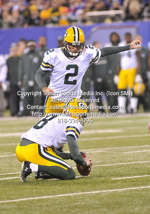04 December 2011: Green Bay Packers # 2 K Mason Crosby setting up to kick field goal during the New York Giants vs.Green bay Packers game at Metlife Stadium ,East Rutherford, New Jersey.Giants 35 Packers 38