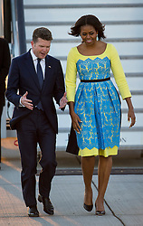 © Licensed to London News Pictures. 15/06/2015. Stansted, UK. First Lady MICHELLE OBAMA is greeted by U.S. Ambassador to th UK, Matthew W. Barzun, as she arrives in the UK at Stansted Airport accompanied by her daughters Malia and Sasha for the start of a three day visit to the UK. During the visit the First Lady and her family will meet with students at Mulberrry School for Girls and have Tea with Prime Minister David Cameron and Samantha Cameron. Photo credit: Ben Cawthra/LNP