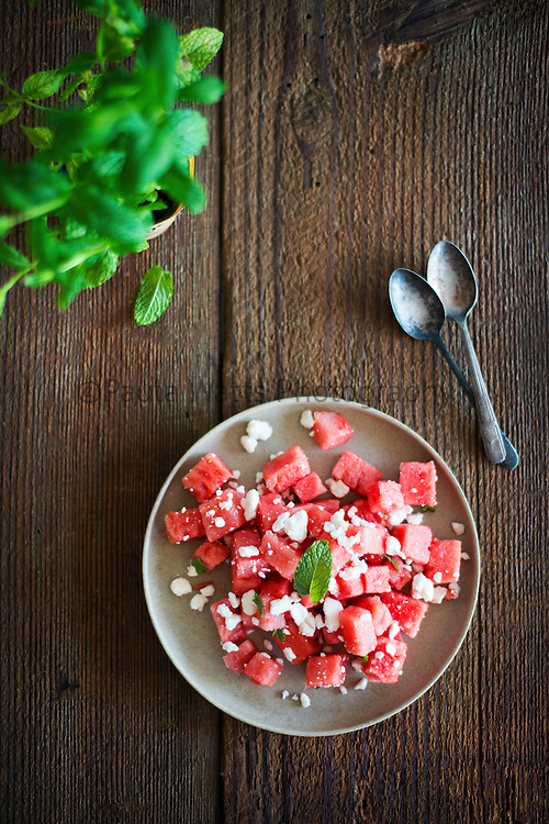 Watermelon Feta Mint Salad on rustic tabletop overhead
