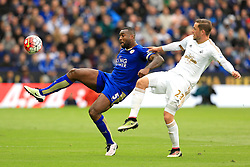 Wes Morgan of Leicester City challenges Gylfi Sigurdsson of Swansea City  - Mandatory by-line: Matt McNulty/JMP - 24/04/2016 - FOOTBALL - King Power Stadium - Leicester, England - Leicester City v Swansea City - Barclays Premier League
