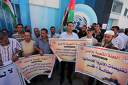 October 11, 2016 - Gaza City, Gaza Strip, Palestinian Territory - Palestinians hold banners during a protest against the UNRWA decision to reduce of the aid in front of the headquarters United Nations Relief and Works Agency (UNRWA), in Gaza city on October 11, 2016  (Credit Image: © Ashraf Amra/APA Images via ZUMA Wire)