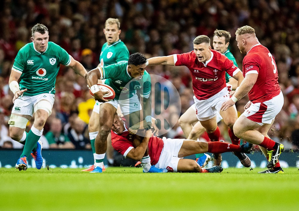Bundee Aki of Ireland under pressure from Scott Williams of Wales<br /> <br /> Photographer Simon King/Replay Images<br /> <br /> Friendly - Wales v Ireland - Saturday 31st August 2019 - Principality Stadium - Cardiff<br /> <br /> World Copyright © Replay Images . All rights reserved. info@replayimages.co.uk - http://replayimages.co.uk