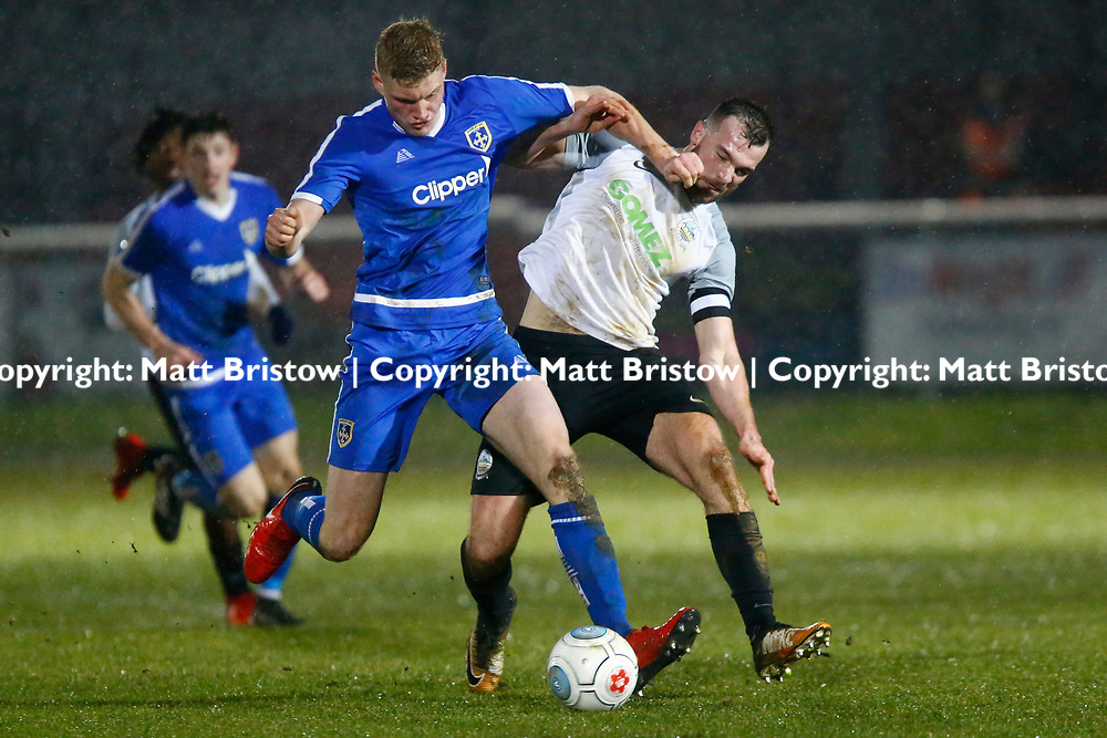 Guiseleys defender Harry Flowers keeps Dover's midfielder Mitch Brundle from the ball during the Vanorama National League match between Dover Athletic and Guiseley at Crabble Stadium, London, England on 27 January 2018. Photo by Matt Bristow.