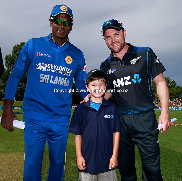 Toby Browne, 7 years old, the winner of the ANZ coin toss promotion with Brendon McCullum captain of the Black Caps and Angelo Mathews captain of Sri Lanka before the first ODI between the Black Caps v Sri Lanka at Hagley Oval, Christchurch. 11 January 2015 Photo: Joseph Johnson / www.photosport.co.nz