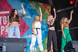 © Licensed to London News Pictures. 13/07/2019; Bristol, UK. FOUR OF DIAMONDS, the first all-girl band to be signed to Virgin since the Spice Girls, at Bristol Pride's 10th anniversary festival in 2019; earlier there was their biggest ever march with thousands of people march in the Pride Parade through Bristol with the rainbow flag in celebration for all sections of the LGBT community. The festival continues on Bristol Downs with an estimated 35,000 people attending. Photo credit: Simon Chapman/LNP.
