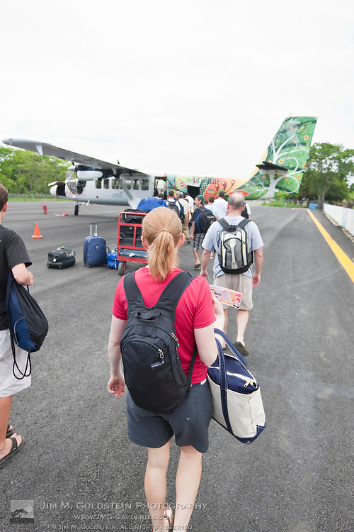 Tourists board a flight at Puerto Jiménez airport outside Corcovado National Park, Costa Rica
