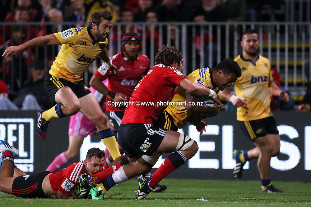 Faifili Levave of the Hurricanes scoreing a try in the tackle of Sam Whitelock and Israel Dagg of the Crusaders during the Investec Super Rugby match between Crusaders v Hurricanes at AMI Stadium, Christchurch. 28 March 2014 Photo: Joseph Johnson/www.photosport.co.nz