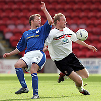 Clyde v St Johnstone...02.10.04<br />Aron Wilford beats Jordan Tait<br /><br />Picture by Graeme Hart.<br />Copyright Perthshire Picture Agency<br />Tel: 01738 623350  Mobile: 07990 594431