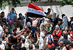 © licensed to London News Pictures. HATAY/ TURKEY. PICTURE DATED. 17/06/2011. Syrian refugees demonstrating against President Bashar al-Assad at the Turkish Red Crescent camp in the Altinozu district of the Turkish city of Hatay, near the Syrian border, on June 17, 2011. More than 9.000 Syrians have now fled the violence of Syria's 3-month anti-regime uprising against the rule of President Bashar al-Assad and crossed into Turkey in the past ten days.Photo credit should read TOLGA AKMEN/LNP