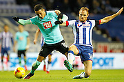 Derby's Thomas Ince (10) fends off the challenge from Wigan's Shaun MacDonald (16) during the EFL Sky Bet Championship match between Wigan Athletic and Derby County at the DW Stadium, Wigan, England on 3 December 2016. Photo by Craig Galloway.
