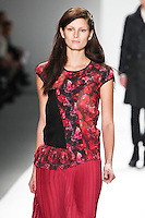 Ava Smith walks the runway wearing Richard Chai during Mercedes-Benz Fashion Week in New York on February 9, 2012