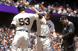 June 28, 2017 - San Francisco, CA, USA - The San Francisco Giants' Nick Hundley, center, celebrates his fourth-inning home run with teammate Austin Slater (53) against the Colorado Rockies on Wednesday, June 28, 2017, at AT&T Park in San Francisco. The Giants won, 5-3. (Credit Image: © Aric Crabb/TNS via ZUMA Wire)