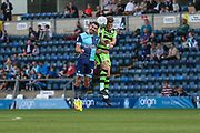 Forest Green Rovers Charlie Cooper(15) and Wycombe Wanderers Matthew Bloomfield(10) jump for the ball during the EFL Sky Bet League 2 match between Wycombe Wanderers and Forest Green Rovers at Adams Park, High Wycombe, England on 2 September 2017. Photo by Shane Healey.