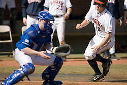 Virginia Cavaliers infielder Patrick Wingfield (8) beats a throw to home to score against Delaware.  The Virginia Cavaliers Baseball Team defeated the Delaware Blue Hens 10-4  in the second of a three game series at Davenport Field in Charlottesville, VA on March 3, 2007.  Virginia leads the series 2 games to 0.