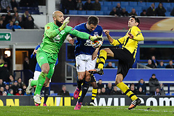 Everton's Tim Howard, Phil Jagielka & Gonzalo Zarate of BSC Young Boys involved in a challenge - Photo mandatory by-line: Matt McNulty/JMP - Mobile: 07966 386802 - 26/02/2015 - SPORT - Football - Liverpool - Goodison Park - Everton v Young Boys - UEFA EUROPA LEAGUE ROUND OF 32 SECOND LEG