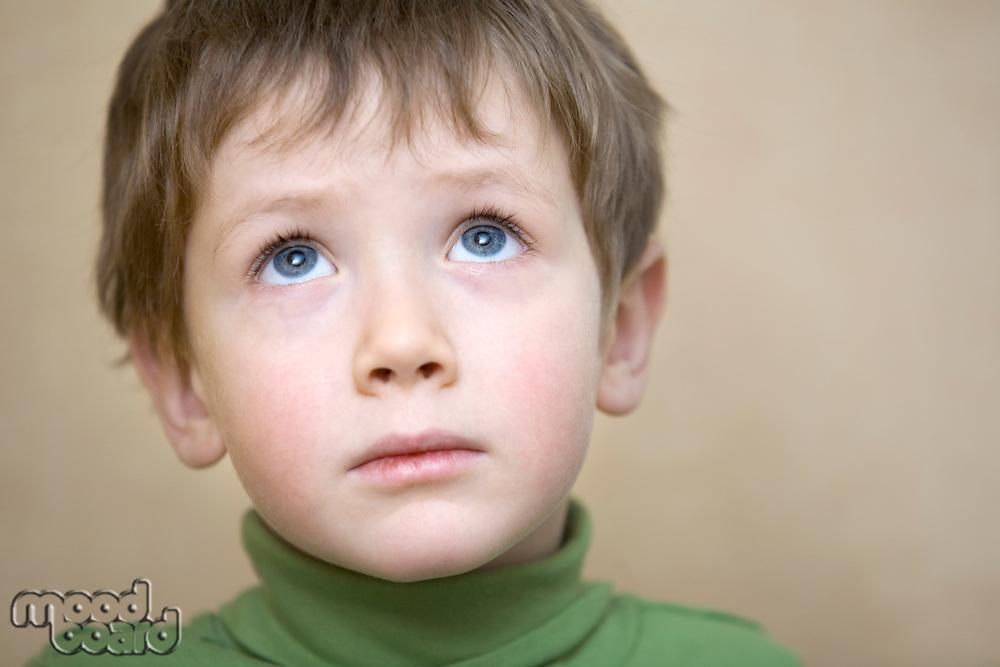 Portrait young boy gazing upwards