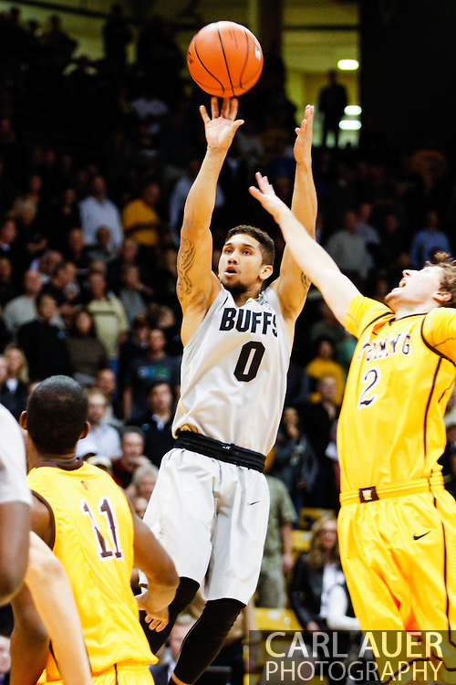 November 13th, 2013:  Colorado Buffaloes junior guard Askia Booker (0) attempts a shot in first half action of the NCAA Basketball game between the University of Wyoming Cowboys and the University of Colorado Buffaloes at the Coors Events Center in Boulder, Colorado