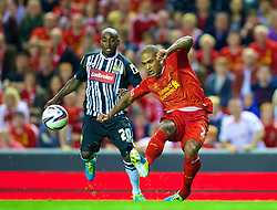 LIVERPOOL, ENGLAND - Tuesday, August 27, 2013: Liverpool's Glen Johnson in action against Notts County during the Football League Cup 2nd Round match at Anfield. (Pic by David Rawcliffe/Propaganda)