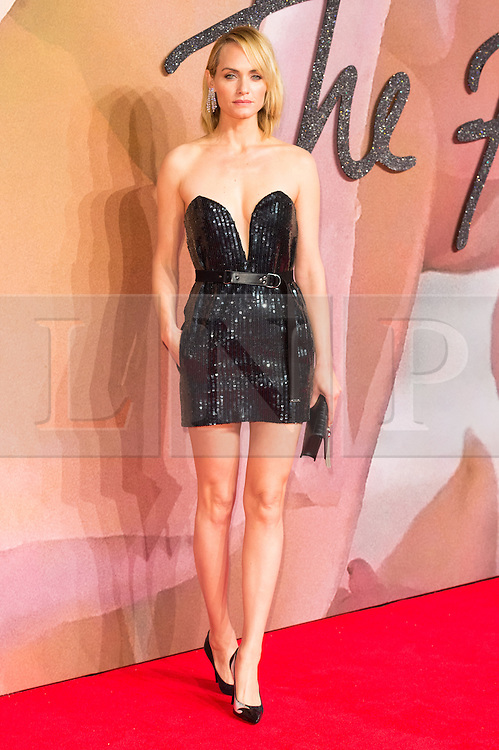 © Licensed to London News Pictures. 05/12/2016. AMBER VALETTA arrives for The Fashion Awards 2016 celebrating the best of British and international fashion. London, UK. Photo credit: Ray Tang/LNP