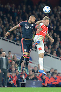 Bayern Munich midfielder Arturo Vidal and Arsenal defender Nacho Monreal challenge for a header during the Champions League  Group F match between Arsenal and Bayern Munich at the Emirates Stadium, London, England on 20 October 2015. Photo by Alan Franklin.