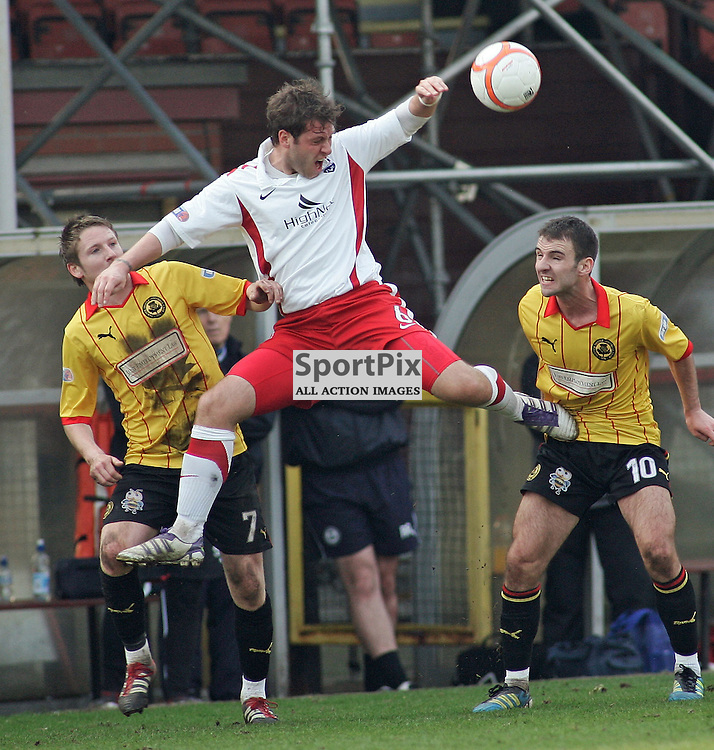 Paul Lawson gets a sore one in the ribs from Paul Cairnery  partick thistle in the irn bru first division clash at firhill. County ran out winners in a tough game with a goal by Colin McMenamin edging closer to the first divisoin title and the premier league picture kevin mcglynn