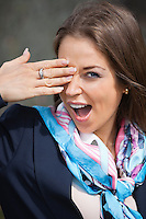Portrait of young businesswoman yawning