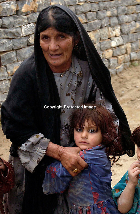 Bibi Mastan holds Bibi Rashida(3),  the daughter  of her son Diliwar at their home in the the town of Yakubi in the district of Khost, Afghanistan May 2, 2005. Diliwar, a 22-year-old farmer and part-time taxi driver, died in December 2002 while being held in the main United States air base at Bagram, north of Kabul. His death was ruled a homicide by the Army medical examiner.<br /> <br /> Photo by Keith Bedford