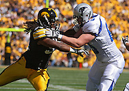 September 4 2010: Iowa Hawkeyes defensive end Adrian Clayborn (94) works against Eastern Illinois Panthers offensive linesman Dominic Pagliara (69) during the first quarter of the NCAA football game between the Eastern Illinois Panthers and the Iowa Hawkeyes at Kinnick Stadium in Iowa City, Iowa on Saturday September 4, 2010. Iowa defeated Eastern Illinois 37-7.