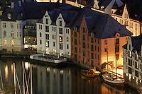 &Aring;lesund 20050513. Hus ved Brosundet / &Aring;lesundet i &Aring;lesund. Til venstre i bildet er en lekter for uteservering om sommeren.<br /> <br /> Art Nouveau houses next to Brosundet / Aalesundet in Aalesund city.<br /> <br /> Foto: Svein Ove Ekornesv&aring;g